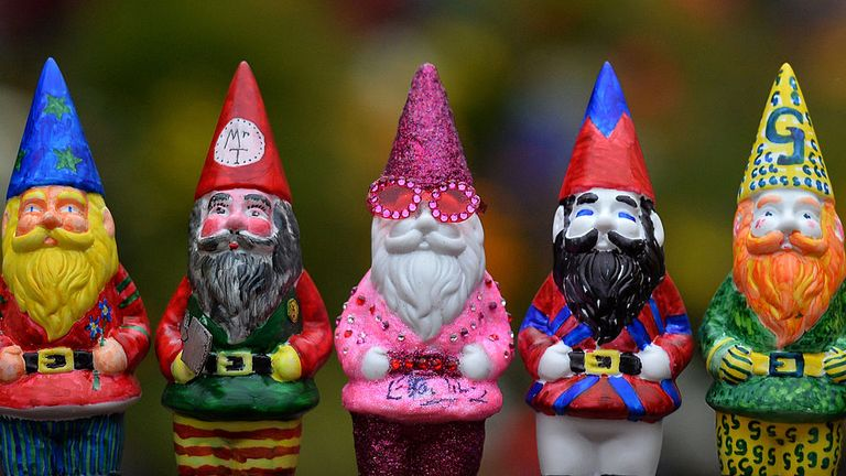 Gnomes designed by various celebrities including Elton John's (centre) on display at the RHS Chelsea Flower Show in 2013