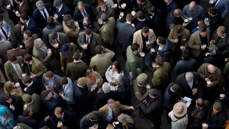 Racegoers drinking in the Arkle Bar before a race at Cheltenham on 13 March