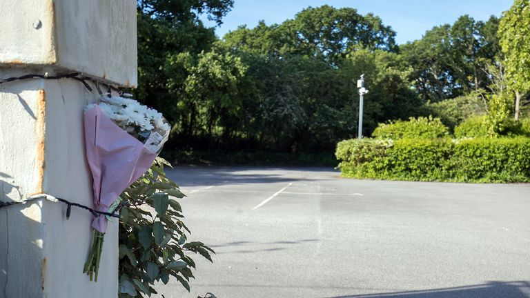 Flowers left at the car park of the Horns Inn in West Parley, near Bournemouth, where Claire Parry was injured Saturday and later died in hospital. Timothy Brehmer, 41, a constable with Dorset Police, who was said to be known to the victim, is appearing by videolink at Poole Magistrates courts, accused of her murder.