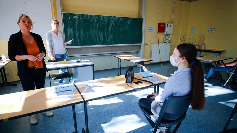 Teachers Claudia Mohme and Nicola Witzlau give lessons at the Freiherr-vom-Stein school after its re-opening, as the spread of the coronavirus disease (COVID-19) continues in Bonn, Germany, April 23, 2020. REUTERS/Wolfgang Rattay