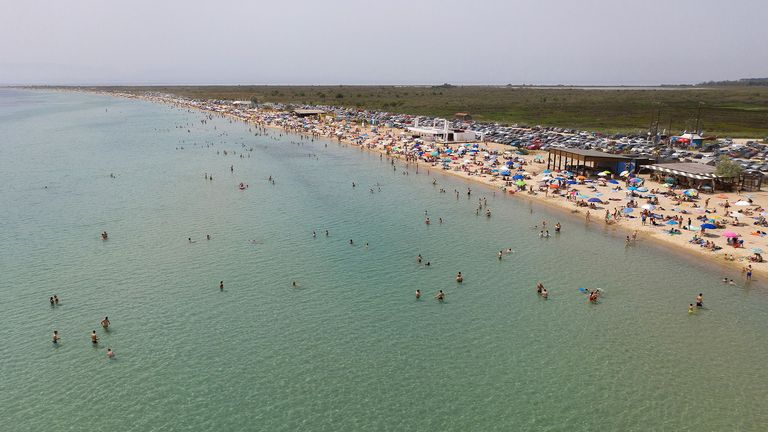 Mandatory Credit: Photo by DIMITRIS TOSIDIS/EPA-EFE/Shutterstock (10648753d).Picture taken by drone shows people enjoying a sunny day atn a beach near the village of Epanomi, Thessaloniki, Greece, 16 May 2020. Hundreds of organized beaches opened to the public on 16 May, though they are to operate subject to strict health and safety guidelines due to the coronavirus pandemic, amid forecasts of a record heat wave..Beaches reopen to public in Greece, Thessaloniki - 16 May 2020