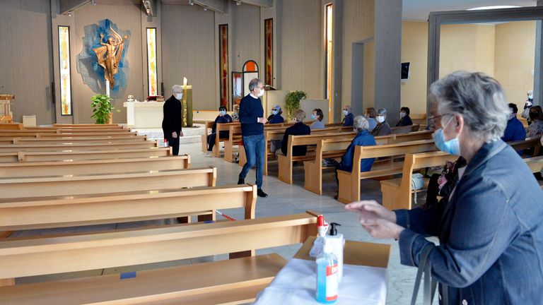 A church in Trento, Italy offer its congregation hand sanitizer