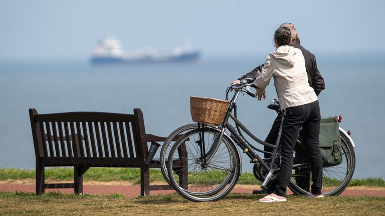 People take a break in their daily exercise at Gorleston-on-Sea in Norfolk