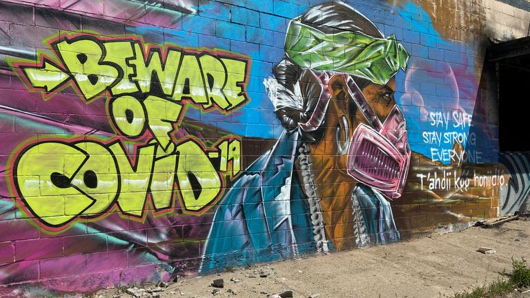 A mural warns residents of the danger of coronavirus disease