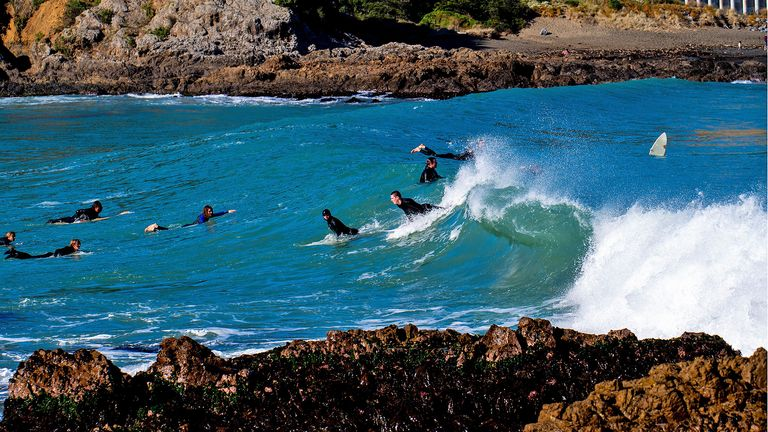 People surfing at Houghton Bay  in Wellington, New Zealand