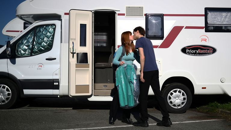 Junior Doctor Amy Kitchen kisses her Junior Doctor husband Jared Leggett goodbye as she makes her way to work from their motorhome in the hospital carpark at The Royal Blackburn Teaching Hospital in East Lancashire following the outbreak of the coronavirus disease. PA Photo. Picture date: Thursday May 14, 2020. The married couple, who were living with parents and in the process of buying their first home, made the decision to isolate in the onsite accommodation to protect their families and be