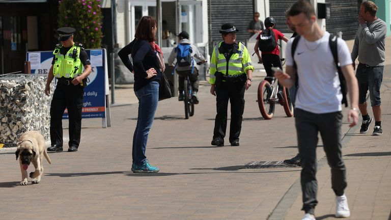Police patrol Brighton seafront as thousands travel to the country's beauty spots