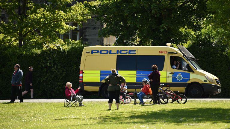 Police speak to users of a park in Birkenhead, Merseyside