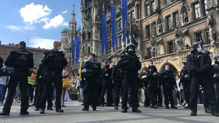 Police officers attend as protesters gather in Marienplatz