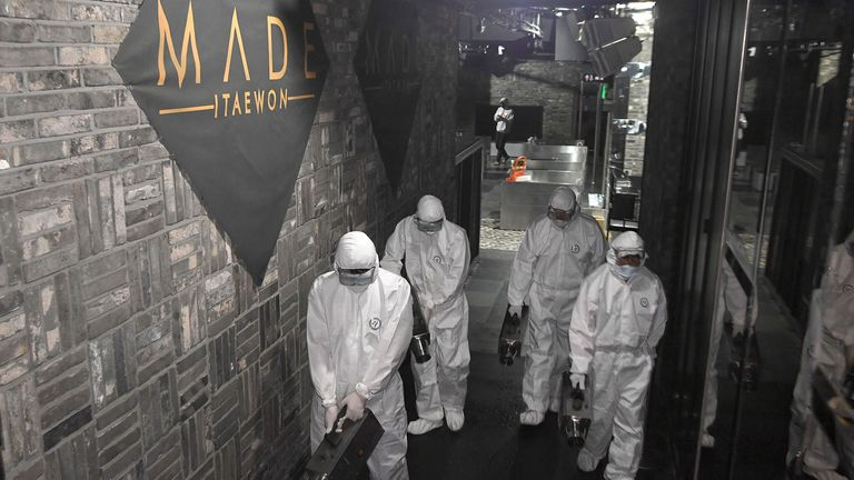 Mandatory Credit: Photo by YONHAP/EPA-EFE/Shutterstock (10643697a).Health officials disinfect the interior of  MADE, a major club in the international tourist district of Itaewon in Seoul, South Korea, 12 May 2020. The club is feared to become a spot of a cluster infection as a man in his 20s tested positive for COVID-19 after visiting the place on 02 May..Health officials investigate possible new cluster infection in Seoul, Korea - 12 May 2020