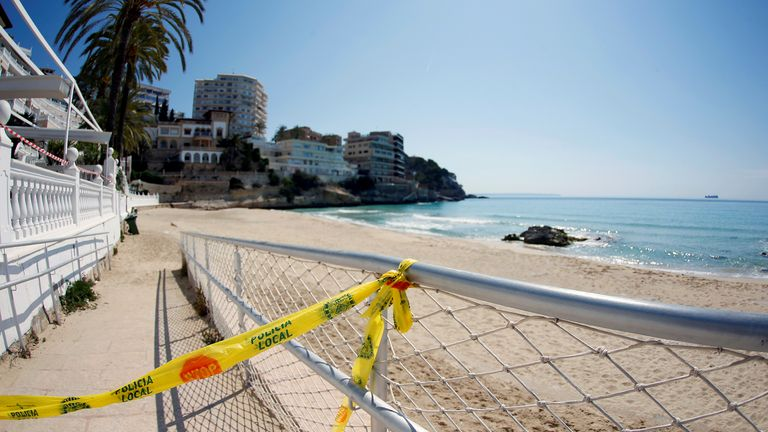 FILE PHOTO: A police restriction tape is seen at the beach of Cala Major during the coronavirus disease (COVID-19) outbreak in Mallorca, Spain April 9, 2020. REUTERS/Enrique Calvo/File Photo