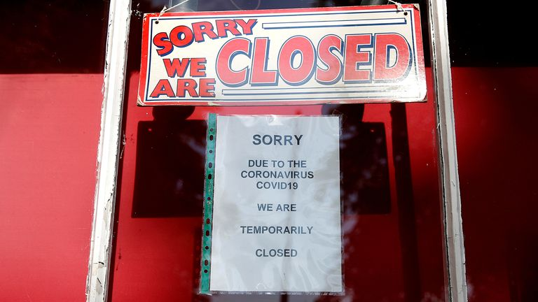 FILE PHOTO: A closed sign is seen in a shop window in Dunham Massey, following the outbreak of the coronavirus disease (COVID-19), Dunham Massey, Britain, May 7, 2020. REUTERS/Phil Noble/File Photo