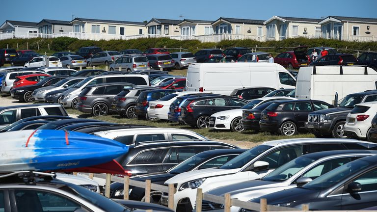 LULWORTH, ENGLAND - MAY 25: Car park at Durdle Door beach on May 25, 2020 in West Lulworth, United Kingdom. The British government has started easing the lockdown it imposed two months ago to curb the spread of Covid-19, abandoning its 'stay at home' slogan in favour of a message to 'be alert', but UK countries have varied in their approaches to relaxing quarantine measures. (Photo by Finnbarr Webster/Getty Images)