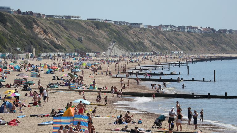 People enjoy the hot weather on Boscombe beach in Dorset, following the introduction of measures to bring the country out of lockdown.