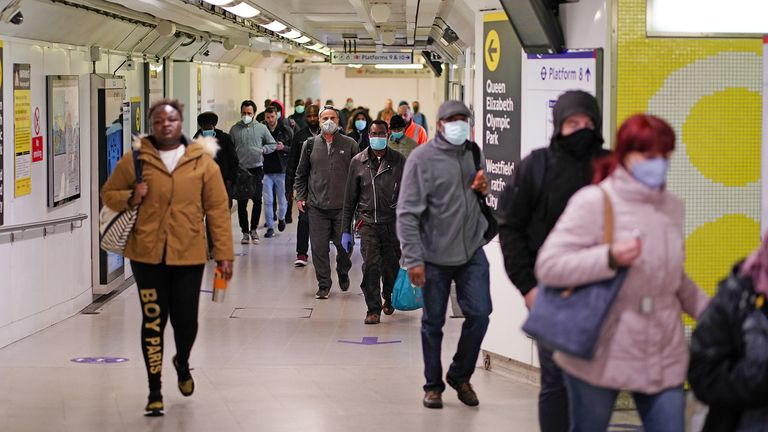 Commuters, some wearing masks are seen at Stratford station, following the outbreak of the coronavirus disease (COVID-19), London, Britain, May 13, 2020. REUTERS/Henry Nicholls