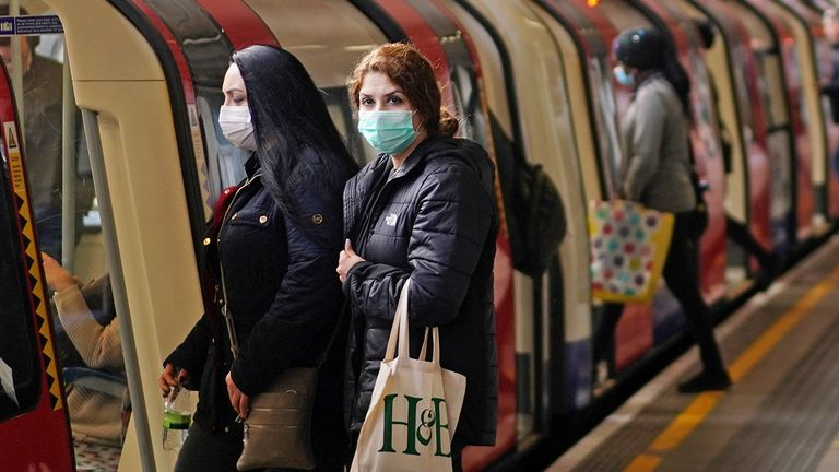 Commuters wearing masks are seen at a London Underground station, following the outbreak of the coronavirus disease (COVID-19), London, Britain, May 13, 2020. REUTERS/Henry Nicholls