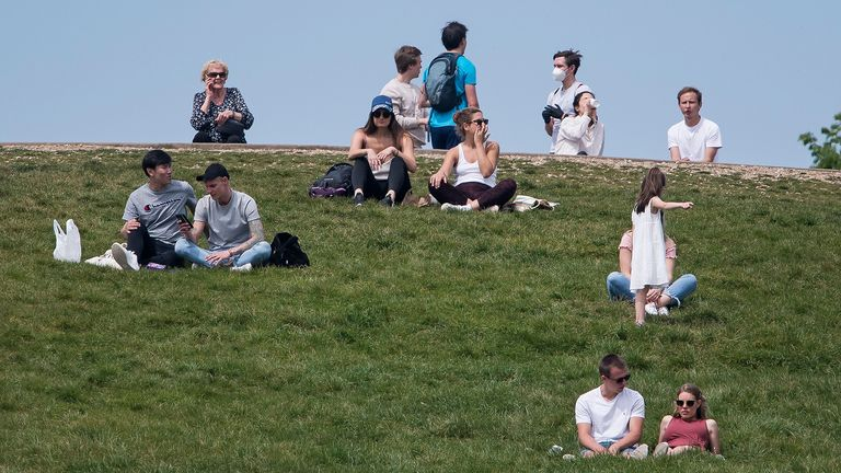 Mandatory Credit: Photo by Ben Cawthra/Shutterstock (10639944x).Members of the public sitting down on Primrose Hill in North London