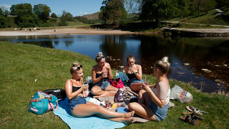 People enjoy the hot weather at Bolton Abbey in North Yorkshire, as people flock to parks and beaches with lockdown measures eased.