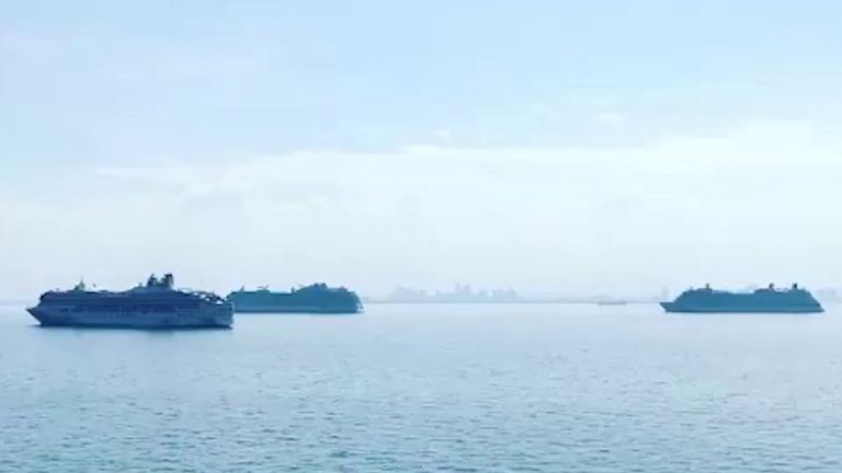 Cruise ships wait in Manila for their crews to be allowed ashore