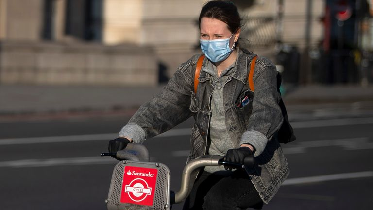 A cyclist wearing a protective face mask on Westminster Bridge, London