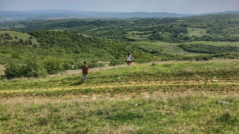 Two children run around the empty countryside of Dagestan. Pic: Anastasia Leonova