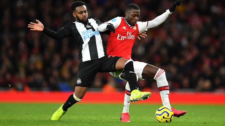 Danny Rose challenges Arsenal's Nicolas Pepe
