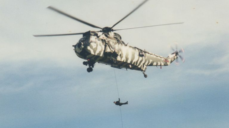 Lt Col Allen engaging in a heli abseil during a training routine