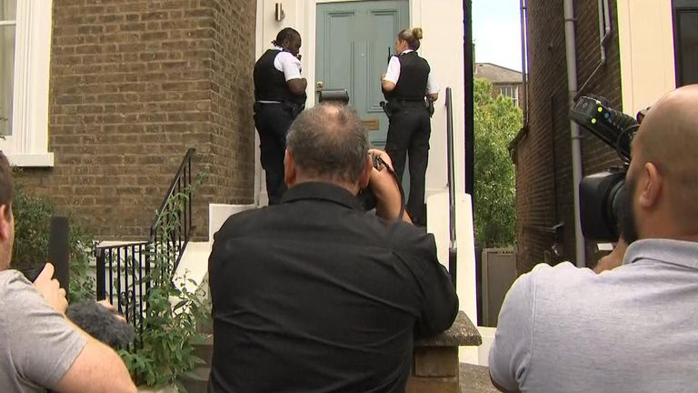 Police officers outside Dominic Cummings house.