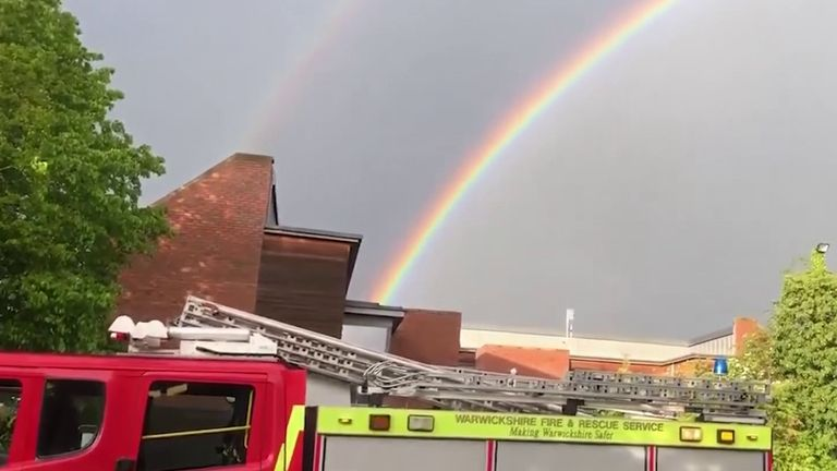 Double rainbow appears behind fire fighters during Clap for Carers event