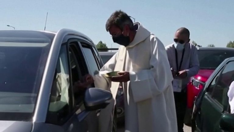 French Catholics attend a drive-in mass