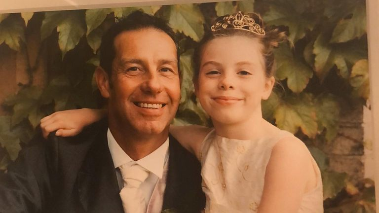Emily Mee as a child with her father