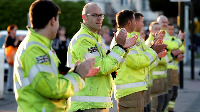 Firefighters at the Luton and Dunstable University Hospital applause during the clap for carers campaign.