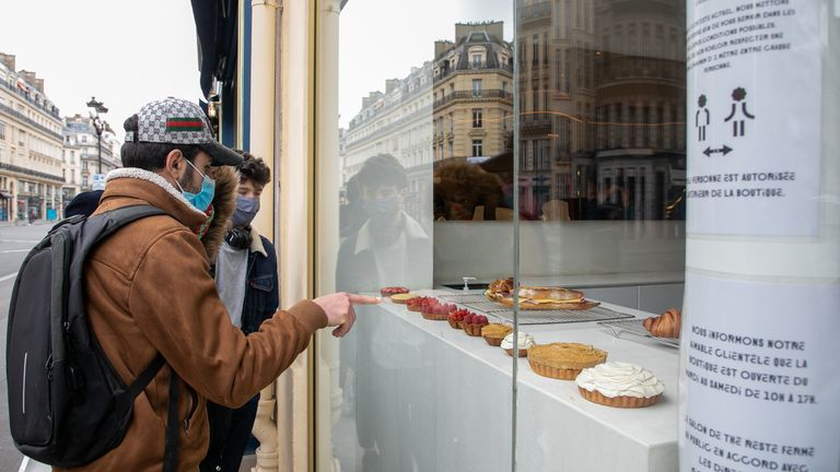 Clients are queueing in front of the Cedric Grolet bakery shop on Avenue de l'Opera