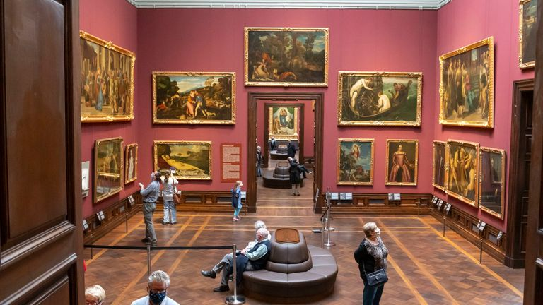 Visitors respect social distancing rules at a reopened museum in Dresden, Germany