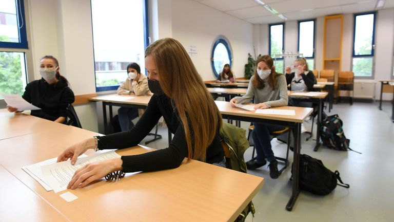 Students of a vocational school for pharmacy technicians participate in class on the first school day after a five-week shutdown due to the spread of the coronavirus disease (COVID-19) in Munich, Germany April 27, 2020