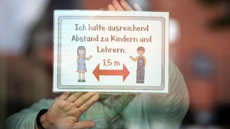Teachers prepare placards with hygiene rules for the school children at Schloss-Schule elementary school during the coronavirus crisis on April 29, 2020 in Heppenheim, Germany