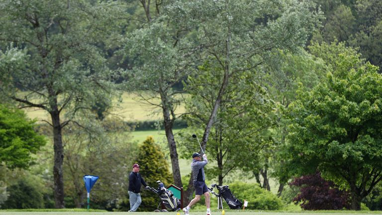 A golfer tees off at Wells Golf Club in Somerset, England