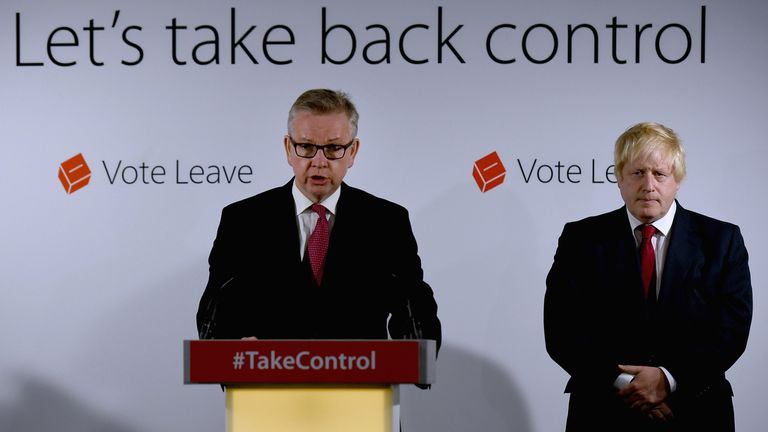 Michael Gove and Boris Johnson in front of the Take Back Control slogan