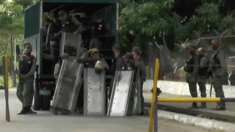 Video grab of members of Bolivarian National Guard as they are deployed outside Los Llanos prison, in Guanare, Portuguesa state, Venezuela on May 2, 2020, after a riot
