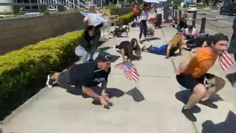 Protesters did fitness routines that can be done with no equipment and without going into a gym facility.