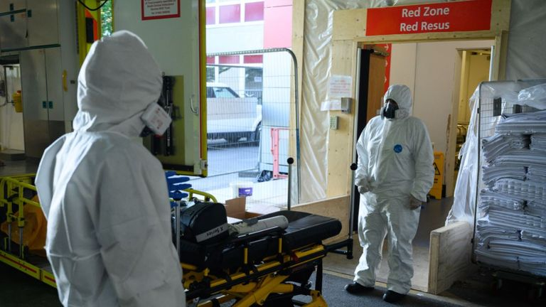 Healthcare workers pictured in PPE in hospital