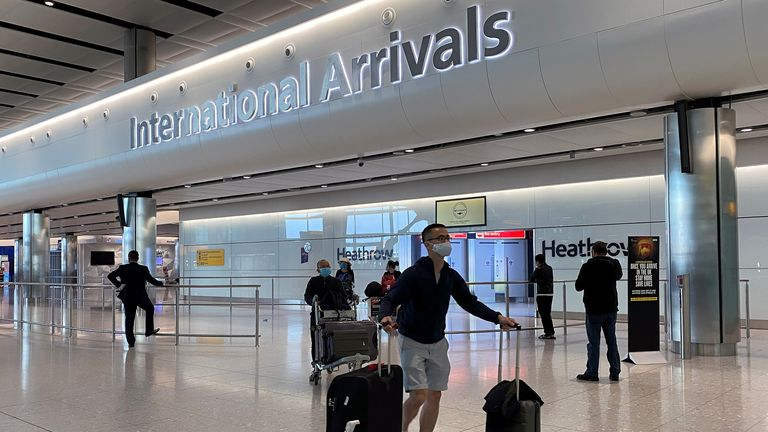 Passengers arrive from international flights at Heathrow Airport