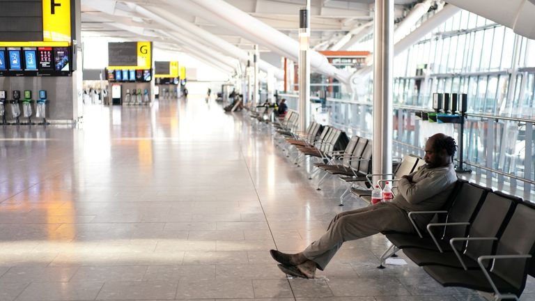 People are seen sleeping at Heathrow airport