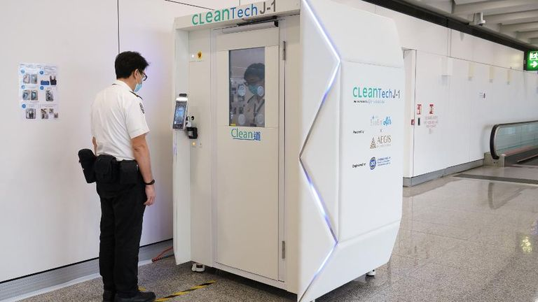 Hong Kong airport is trialling a full-body disinfectant booth. Pic: Hong Kong International Airport