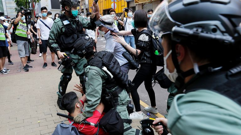 Anti-government demonstrators scuffle with riot police ahead of the bill being approved