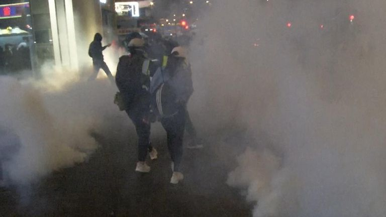 Protesters surrounded by tear gas