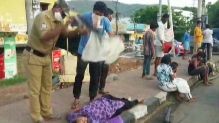 People fan a woman taken ill during the leak