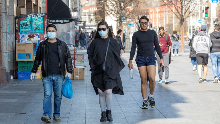 People wear face masks as a precautionary measure against coronavirus in Dublin