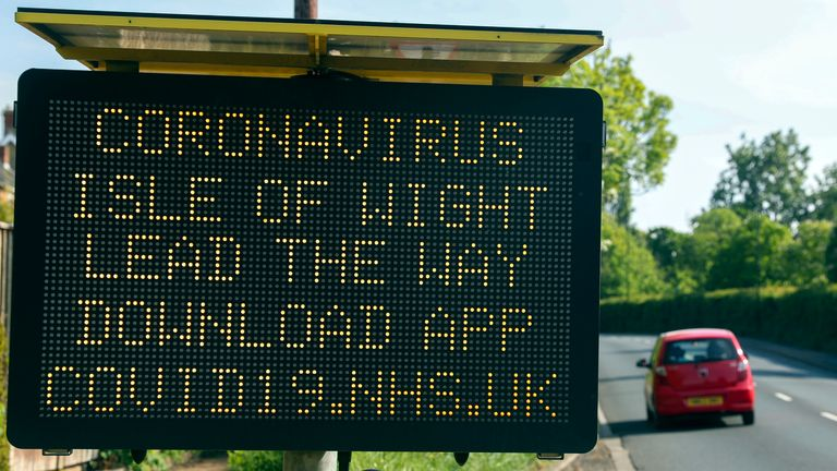 A sign telling people in the Isle of Wight to download the NHS coronavirus contact tracing app