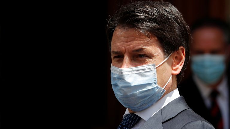 Giuseppe Conte is seen leaving the Senate in Rome on Wednesday